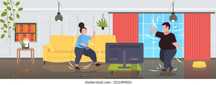 fat obese couple exercising during tv show overweight man woman training while watching fitness program home workout weight loss concept modern living room interior full length horizontal