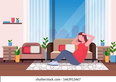fat obese woman doing sit-ups press abdominal exercises girl training workout weight loss concept modern living room interior flat full length horizontal
