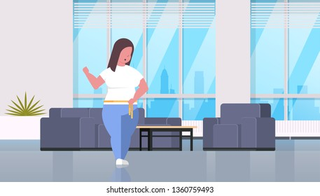 fat obese woman measuring her waistline overweight girl using tape measure weight loss concept modern living room interior flat full length horizontal