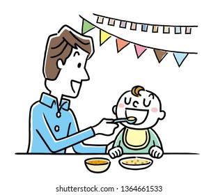 Father feeding a baby