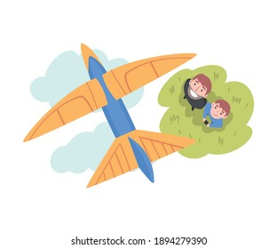 Father and his Son Launching Airplane Model, Happy Parent and Child Spending Time Together Outdoors Cartoon Style Vector Illustration