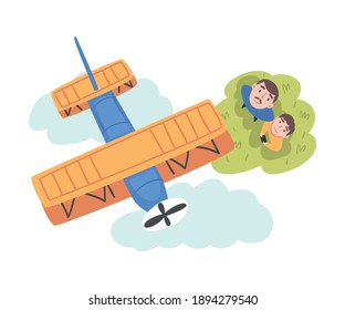 Father and his Son Launching Airplane Model, View from Above of Happy Parent and Child Spending Time Together Outdoors Cartoon Style Vector Illustration