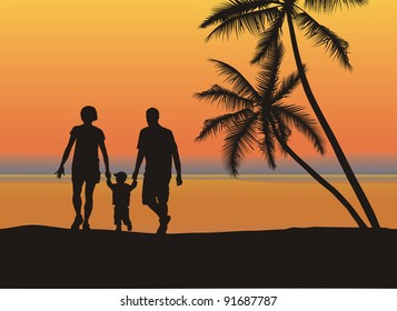 Father and mother holding son's hand on the beach