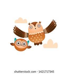 Father owl with his kid owl flying in the cloudy sky