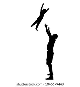 father throws his son up. Silhouettes of father and son.