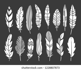 Feather bohemian elements on dark background. Vector decorated feathers graphic set