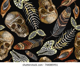 Feathers, fish bone and indian skull embroidery seamless pattern. Beautiful feathers of tropical birds, skeleton of fish and human skull classic embroidery seamless pattern