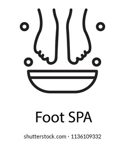 Feet dipped in a bowl containing fluid with bubble drops representing foot spa