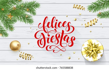 Felices Fiestas Navidad Spanish Happy Holidays golden decoration and calligraphy font for greeting card white wooden background. Vector Christmas or New Year golden shiny gift Xmas decoration design