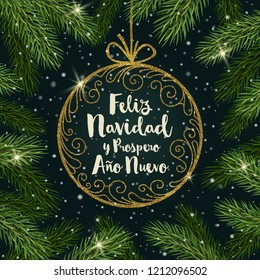 Feliz navidad - Christmas greetings in Spanish. Glitter gold ornate bauble with brush calligraphy Christmas greeting  surrounded by Christmas tree branches.