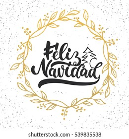 Feliz Navidad - lettering Christmas and New Year holiday calligraphy phrase on Spanish isolated on the white background with golden wreath. Fun brush ink typography