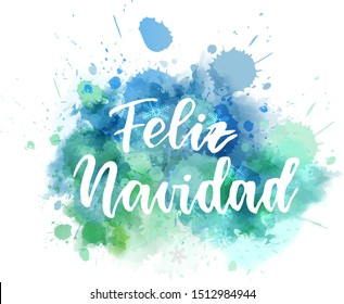 Feliz Navidad - Merry Christmas in Spanish. Abstract watercolor paint splash background. Holiday concept.