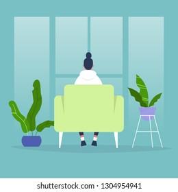 Female character sitting in a chair in front of the window. Back view. Interior concept. Flat editable vector illustration, clip art