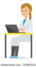 A female doctor wearing a white coat is operating a laptop computer