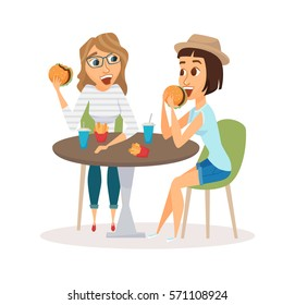 Female friends eating fast food meal in restaurant. Two people sitting, talking and having lunch burgers, fries and drinking soda. Meeting of young fun and smiling women in mall