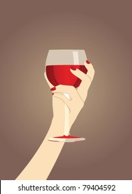 female hand with a glass of red wine