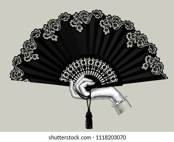 Female hand holding the black open fan with a tassel. Vintage engraving stylized drawing. Vector illustration