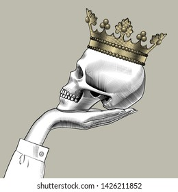 Female hand holding a human skull half-face. Human skull full face with a gold crown. Hamlet skull. Vintage engraving stylized drawing. Vector illustration