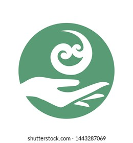 female hand holding Maori spiral shape symbol, based on silver fern frond, meaning new life. vector, logo icon