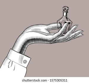 Female hand holding a retro perfume bottle on the palm. Vintage engraving stylized drawing. Vector illustration