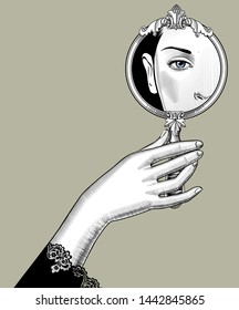 Female hand holding a round decorative mirror with a reflection of woman's eye. Vintage engraving stylized drawing. Vector illustration