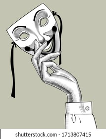 Female hand with a Joker mask in retro style. Vintage engraving black and white stylized drawing. Vector illustration