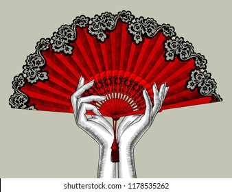 Female hands with red open fan. Vintage engraving stylized drawing. Vector illustration
