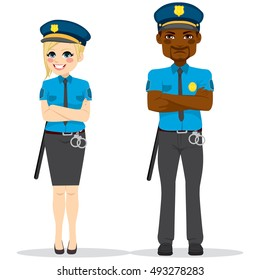 Female and male police officers with crossed arms wearing uniform standing