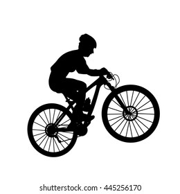 Female mountain bike rider. Cross country racing. Uphill climbing ascent.