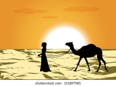 female silhouette leads a camel through the desert at sunset
