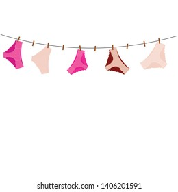 female underwear on a rope with clothespins