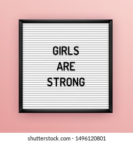Feministic quote on square white letterboard with black plastic letters. Feminine vintage inspirational vector poster 80x, 90x. Girls are strong