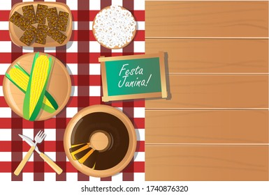 festa junina food table with green corn, carrot cake, popcorn and sweet kidney top view