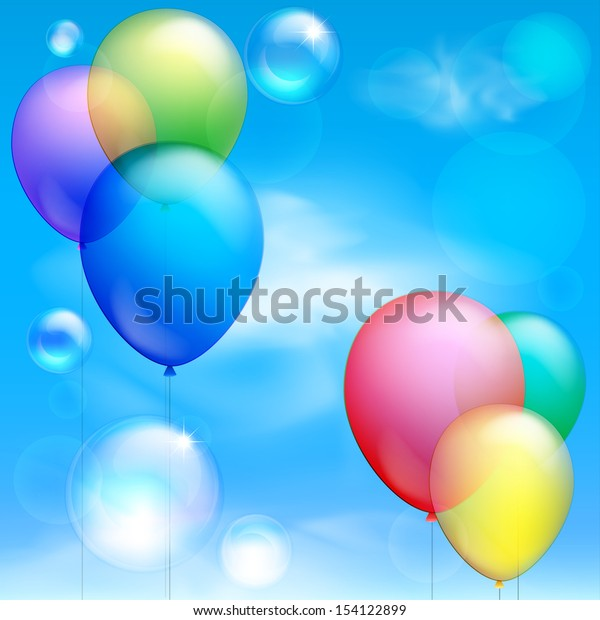 Festive balloons and bubbles against the blue sky and clouds