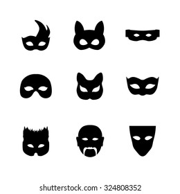 Festive carnival mask icons. Isolated vector set of silhouette black disguises for masquerade costumes on white. Halloween monsters mask illustration.
