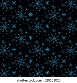 Festive Christmas background with blue snowflakes on a black background