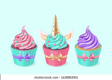 Festive unicorn cupcakes set.  Cake with golden horn and cream on blue background