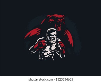 Fighter mixed martial arts is in combat stance. Against the backdrop of the silhouette of a bear.