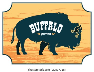 figure blue buffalo on the orange wooden sign with text