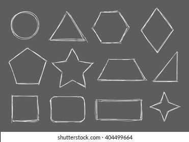 Figures and shapes drawn with chalk on blackboard