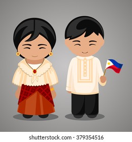 Filipinos in national dress with a flag. A man and a woman in traditional costume. Travel to Philippines. People.