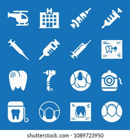 Filled set of 16 medical icons such as hospital, helicopter, dental floss, dental drill, records, implants, molar, canine, teeth, vaccine, syringe