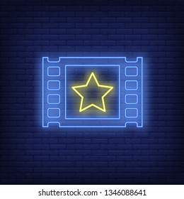 Film cadre neon sign. Glowing film frame with yellow star on brick wall background.Vector illustration can be used for cinema, entertainment, filming