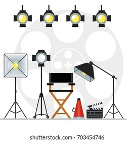 Film directors chair with megaphone, projector, camera and clapboard and softbox. Work on the set of the film. Flat vector cartoon illustration. Objects isolated on a white background.