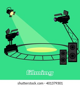 Film shootings camera and projector. Equipment for filming, professional camera on circular rails, it is glowing a bright spotlight and speakers for sound isolated in studio green. Vector illustration