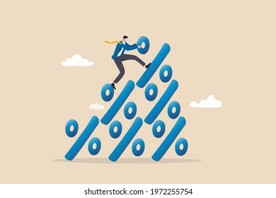 financial growth profit, sale or discount, interest rate or inflation percentage concept, businessman climbing to the top pile of percentage signs metaphor of increasing in percent. - Shutterstock ID 1972255754