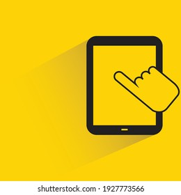 finger touching on smartphone with shadow on yellow background