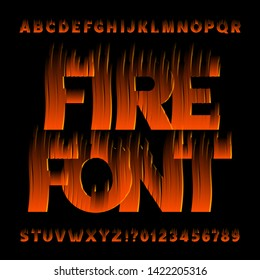 Fire alphabet font. Flame effect type letters and numbers on black background. Stock vector typescript for your design.