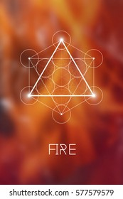 Fire element symbol inside Metatron Cube and Flower of Life in front of natural blurry background. Sacred geometry magic sign futuristic vector design.