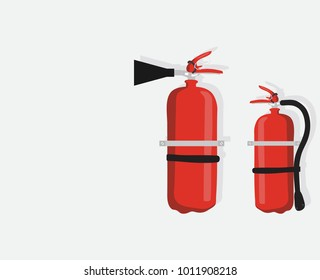 Fire extinguisher on the gray wall.Two Fire extinguisher, isolated on white background